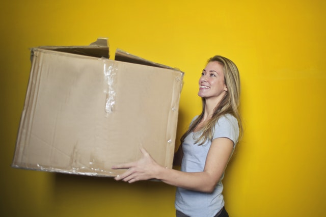 https://www.pexels.com/photo/woman-in-grey-shirt-holding-brown-cardboard-box-761999/